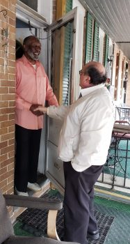 Bill Marker campaigning with a neighbor
